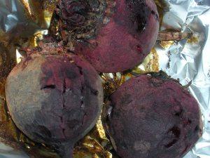 three roasted beets on foil