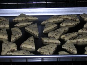 uncooked linseed crackers on the cookie sheet in the oven