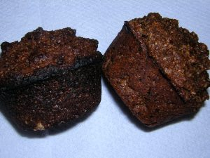 one burnt bran muffin, one not burnt bran muffin