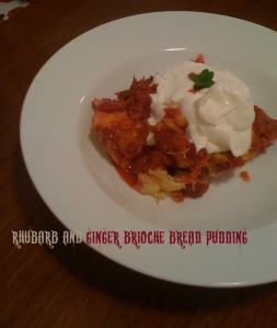 bread pudding with whip cream and mint sprig in large shallow white bowl