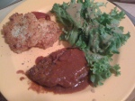 masher cakes, steak in lots of steak sauce and salad