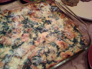 pan of spinach artichoke bread pudding