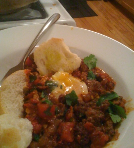 Lamb sausage ragout with poached egg